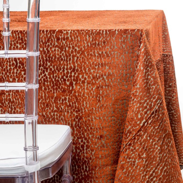 orange chenille speckled tablecloth rentals in New Jersey. For weddings or parties. Tablecloth and napkin rentals by Chaya Sara Thau